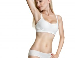 Female waxing armpit in a beauty salon. Depilation. Epilation